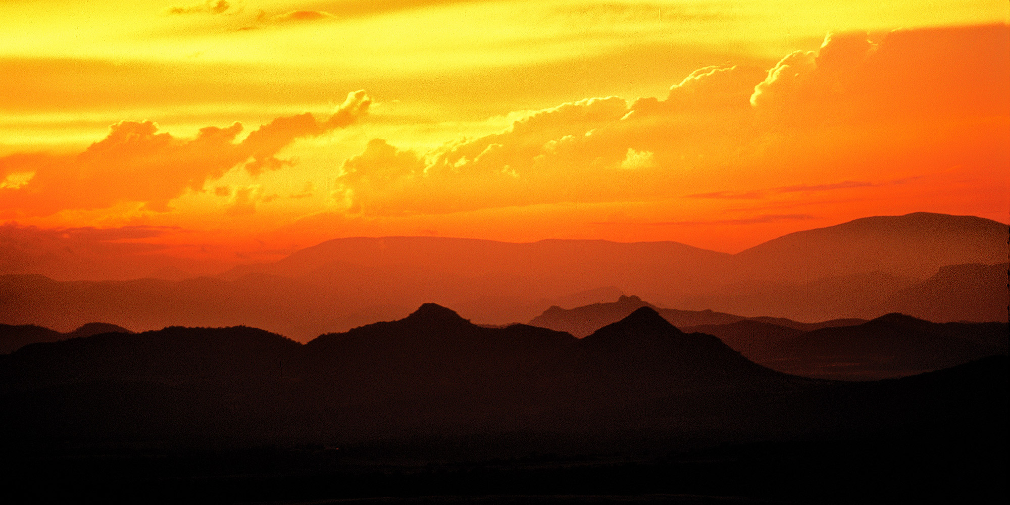 The sky flames at sunset over Pikes Peak massif from above Westcliffe.