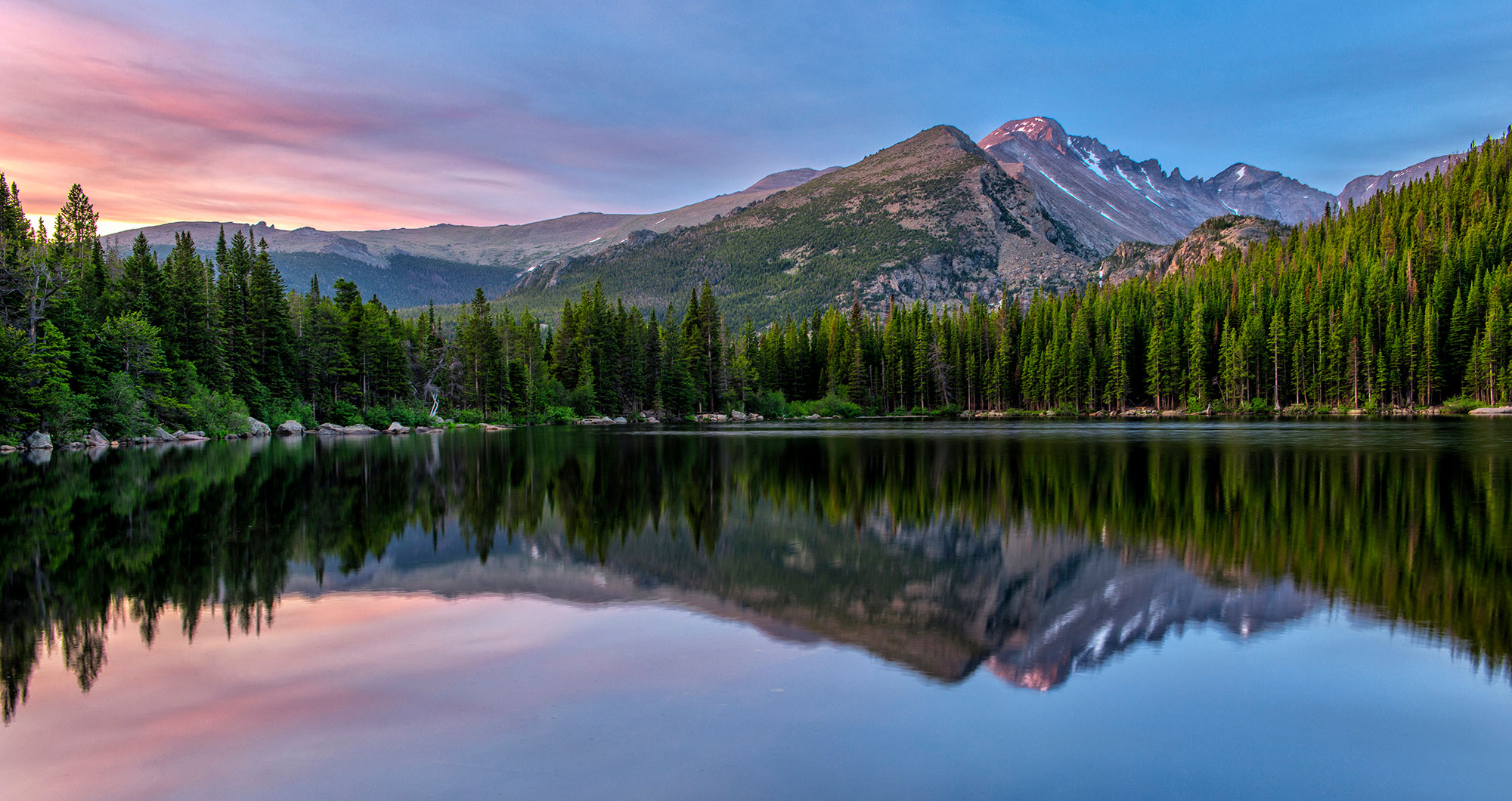 Bear Lake provides an almost perfect  sunrise relection for Long's Peak in the Glacier Basin section of Rocky Mountain National Park, Colorado